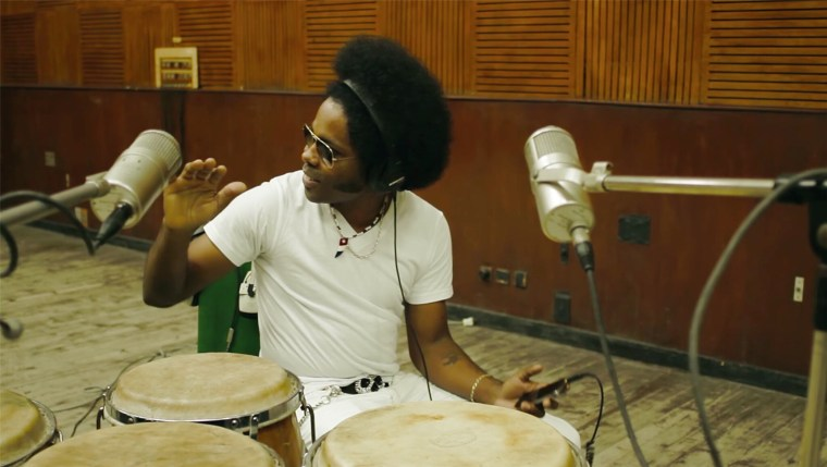 Alex Cuba recording with congas