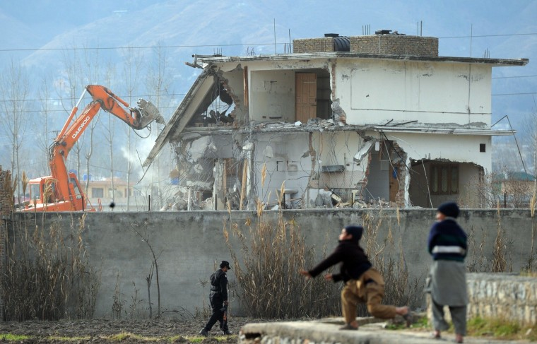 Image: Osama bin Laden's compound in Abbottabad is knocked down in 2012
