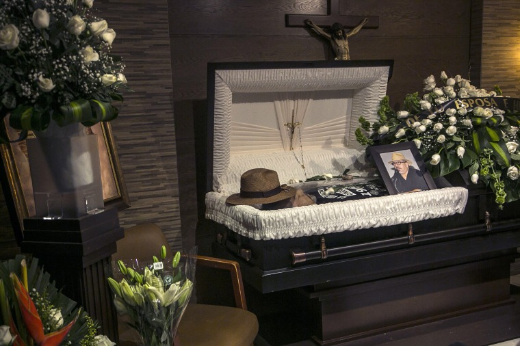 The hat of murdered journalist Javier Valdez lays on his forehead inside a funeral home before his wake begins in Culiacan, Mexico, Tuesday, May 16, 2017.