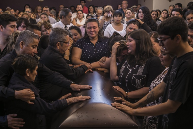 Friends and relatives say their last goodbyes during the funeral mass of slain journalist Javier Valdez, in Culiacan Mexico, Tuesday, May 16 2017.