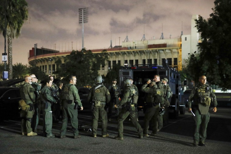 Image: ATF agents gather for a briefing in the parking lot