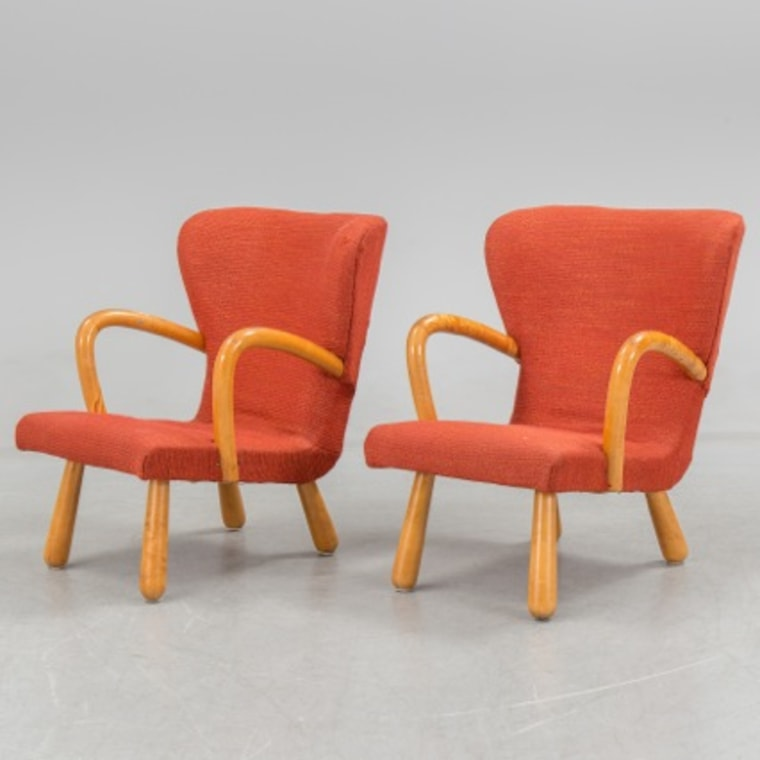 "A pair of ""clam"" chairs sold in 2014 for nearly $65,000, thought to be made by famed Danish architect Philip Arctander. Auction prices came down after it turned out they were just from Ikea."