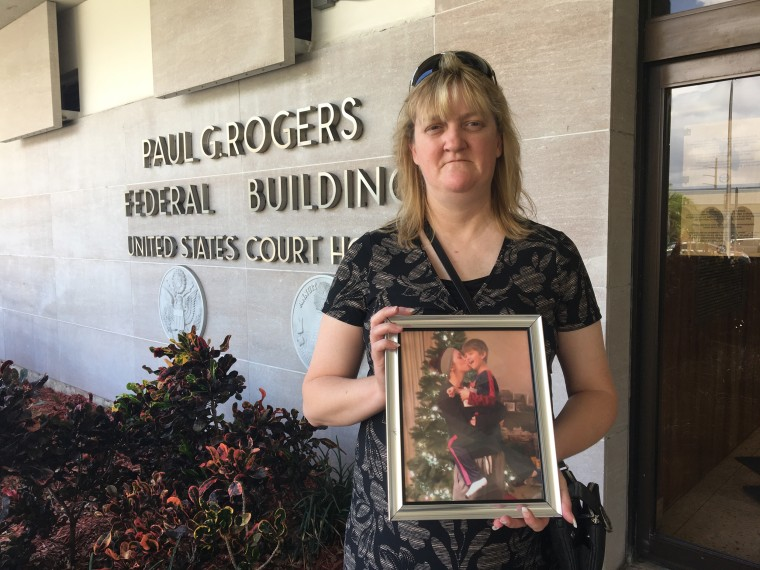 Image: Sandy Hinkle holds a photo of her daughter Kaitlyn Cruea