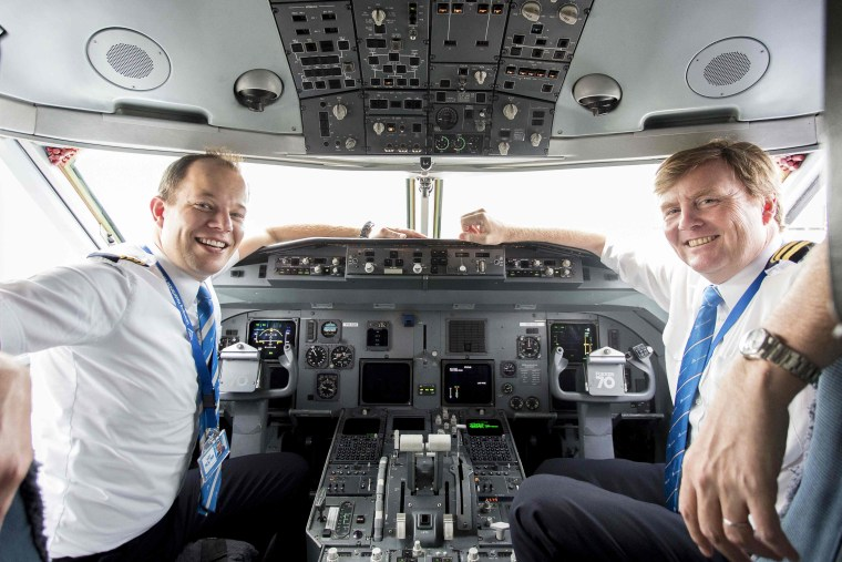 Image: Dutch King Willem-Alexander (R) inside the cockpit of a Fokker 70 with captain Maarten Putman (L).