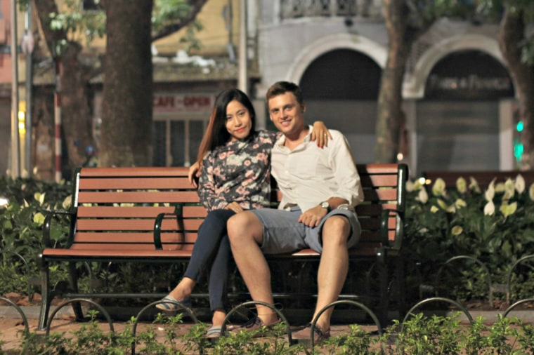 Austin Klemmer poses with Huyen Nguyen after he proposed to her in November 2015 in Hanoi, Vietnam. The couple married in a civil ceremony in 2016.