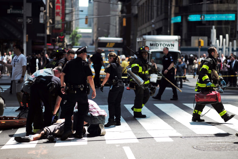 Image: First responders arrive at the scene after a car plunged into pedestrians in Times Square