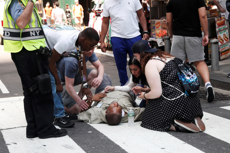 Image: An injured man is seen on the sidewalk in Times Square