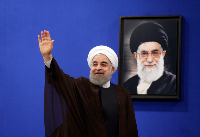 Image: Iranian President Hassan Rouhani gestures during a televised speech after his election victory in Tehran