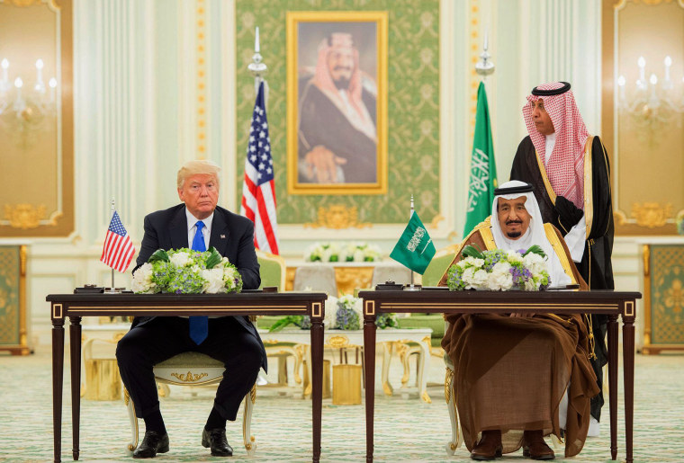Image: President Donald Trump and Saudi Arabia's King Salman bin Abdulaziz al-Saud attend a signing ceremony