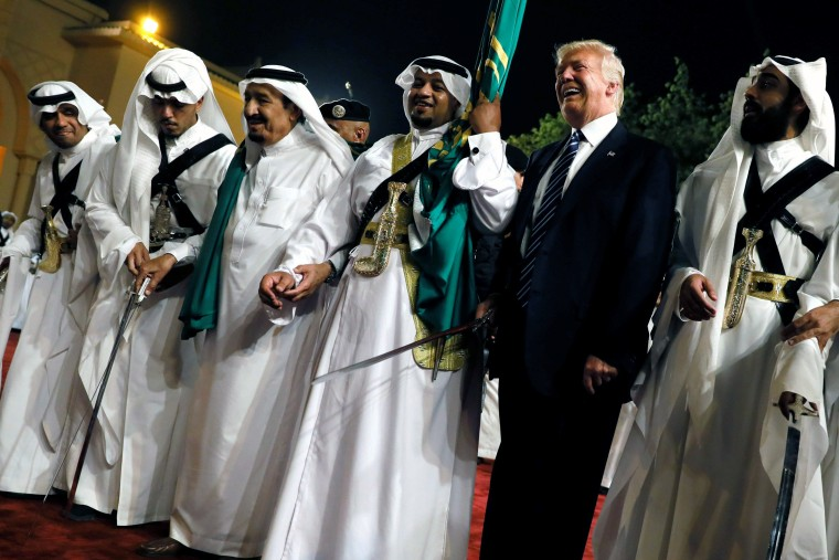 Image: Trump dances with a sword as he arrives to a welcome ceremony by Saudi Arabia's King Salman at Al Murabba Palace in Riyadh