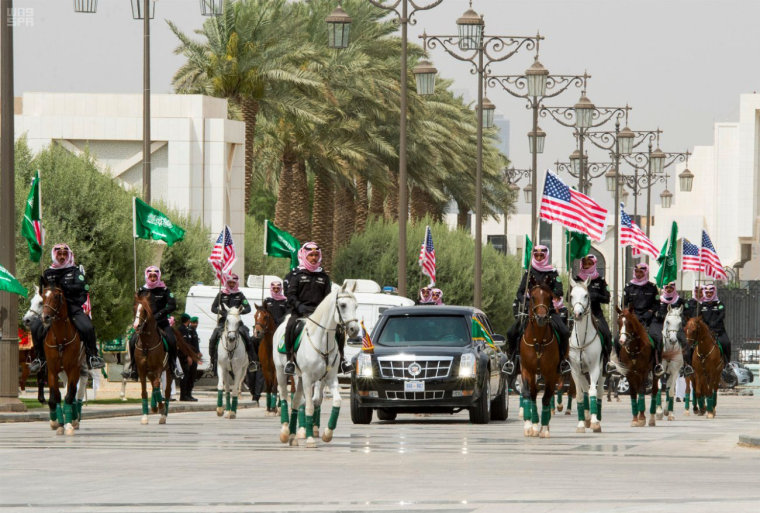 Image: Members of Saudi Royal guard ride horses as U.S. President Donald Trump arrive at the Royal Court in Riyadh