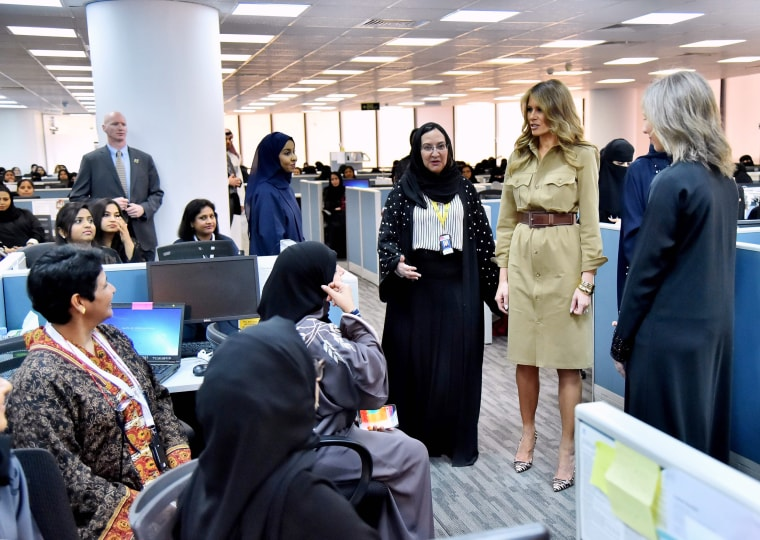 Image: Melania Trump speaks with employees during a visit to the GE All-Women Business Process Services