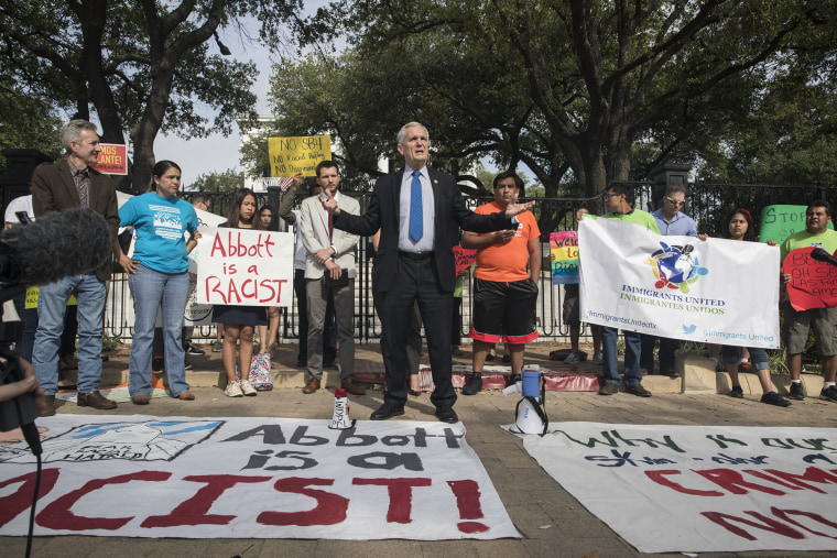 Image: Doggett speaks during a protest outside of the Texas Governor's Mansion in Austin