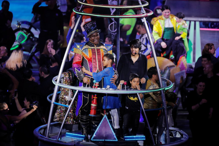 Image: Ringmaster Johnathan Lee Iverson stands with members of his family after the last show of the Ringling Bros. and Barnum & Bailey circus at Nassau Coliseum in Uniondale, New York