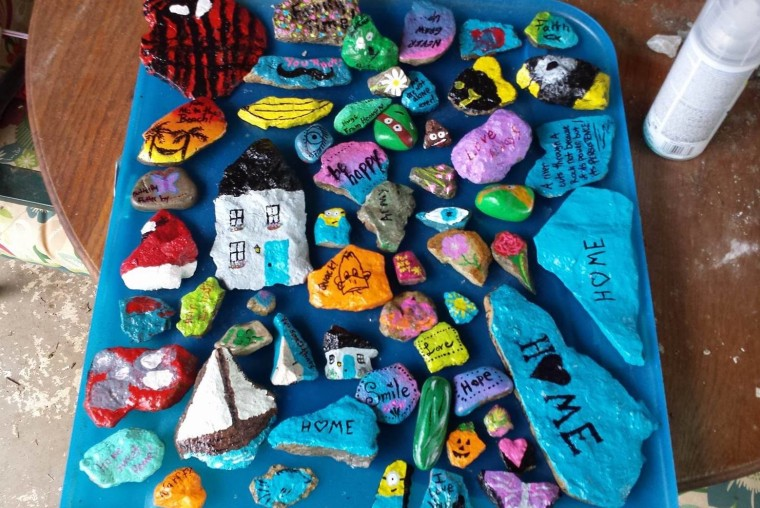 Sarah Nalley serves as a moderator for the Nelson County, Kentucky rock group and says she and her two children love painting rocks together.