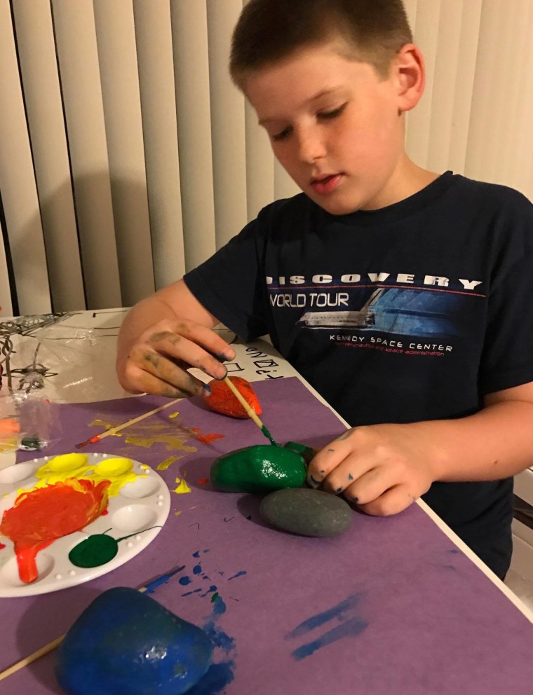 Carrie Cerve, a moderator of the Brevard County, Florida rock group says her son, Elijah, 10, loves to paint, hide and find rocks.