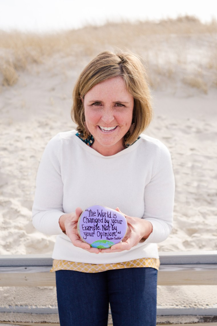 Megan Murphy, founder of the Kindness Rocks Project, with one of her painted rocks.