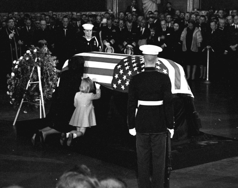 Jacqueline Kennedy kisses the casket of her husband, President John F. Kennedy, lying in state in the rotunda of the U.S. Capitol on Nov. 24, 1963.