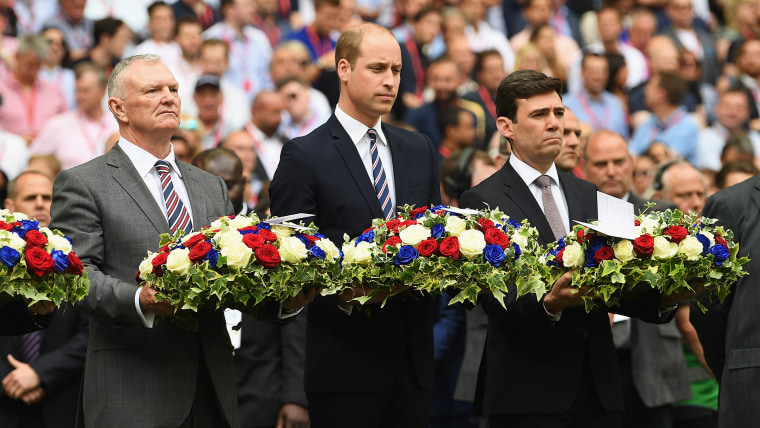 A hush fell over Wembley Stadium as they laid the wreaths in England's colors.