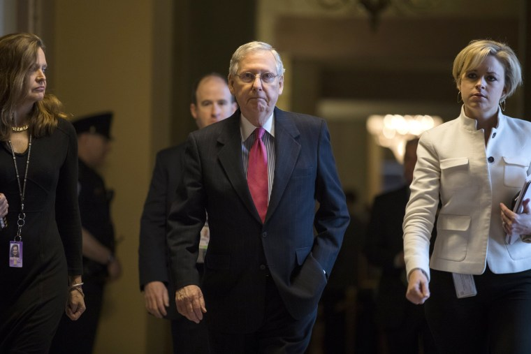 Image: McConnell walks to the Senate floor for procedural votes on the confirmation of Supreme Court nominee Neil Gorsuch