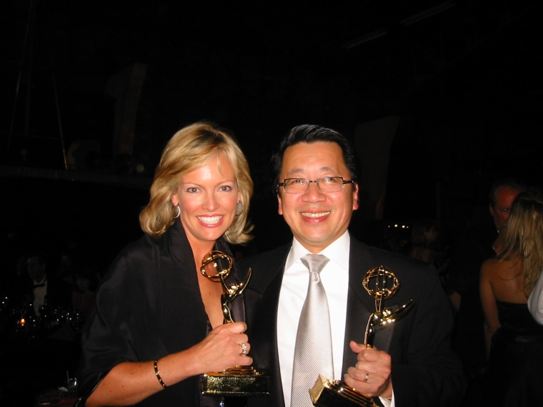 Bay Area journalists Julie Haener and Ben Fong-Torres with Emmys for hosting the San Francisco Chinese New Year Parade in 2004.