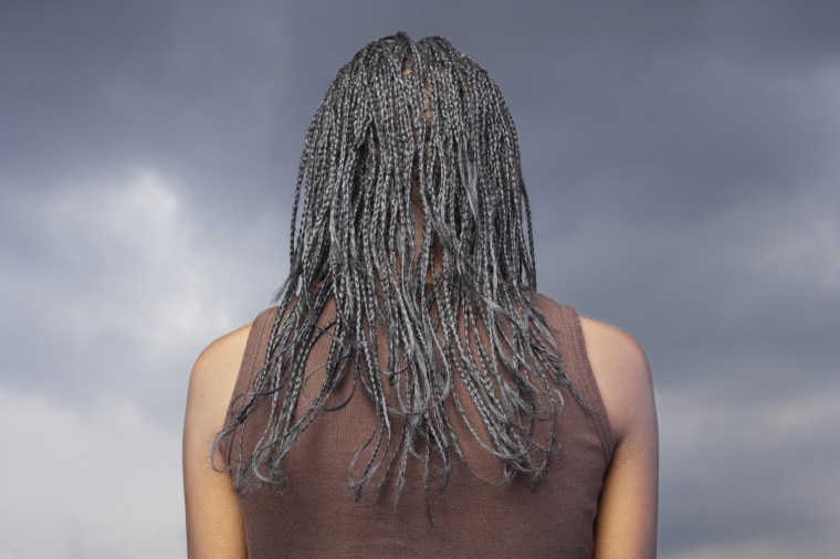 Image: Woman with braided hair, rear view