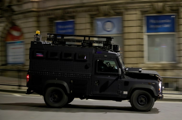 Image: An police vehicle patrols the Manchester Arena