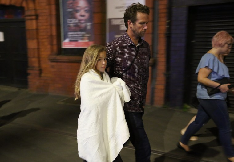 Image: Members of the public are escorted from the Manchester Arena, following the blast