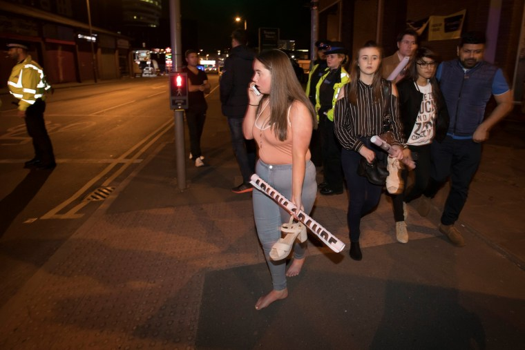 Image: Concert goers react after fleeing the Manchester Arena