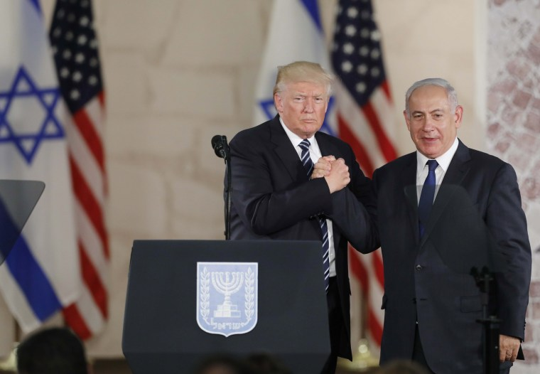 Image: Trump and Netanyahu clasp hands