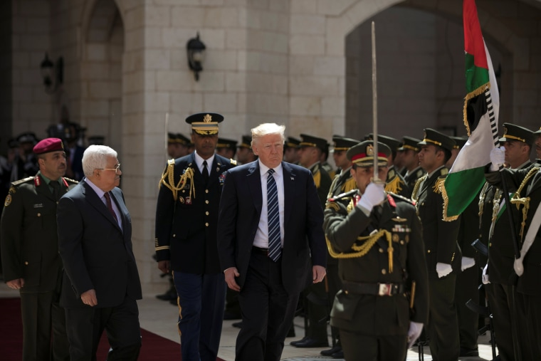 Image: U.S. President Donald Trump and Palestinian President Mahmoud Abbas review the honor guard during a reception ceremony at the presidential headquarters in the West Bank town of Bethlehem