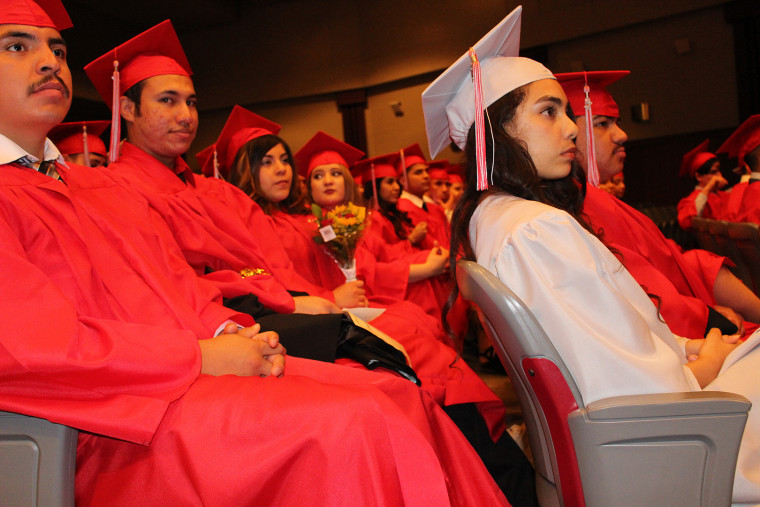 High school seniors from the Oklahoma City Public Schools participate in a graduation ceremony for refugees, immigrants, and English language learners. They also plan to participate in the full commencement.