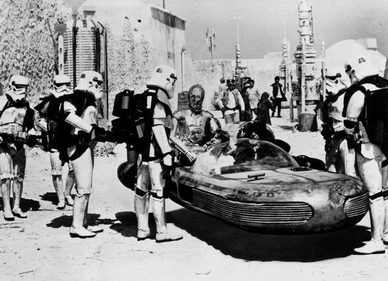 Image: Sandtroopers question Luke Skywalker and Obi-Wan Kenobi