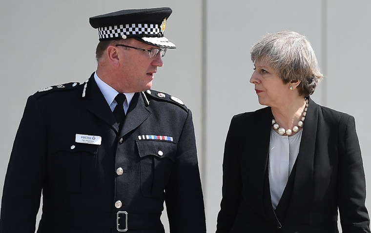 Image: Britain's Prime Minister Theresa May walks with Chief Constable of Greater Manchester Police, Ian Hopkins