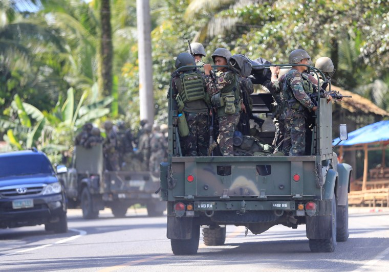 Image: Military vehicles carrying government troops head to Marawi City