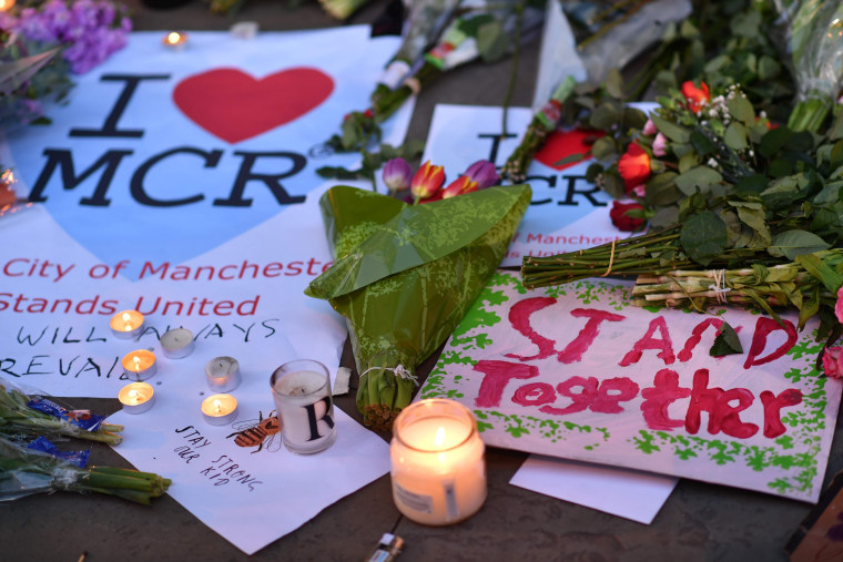 Image: Message and floral tributes in Manchester's Albert Square