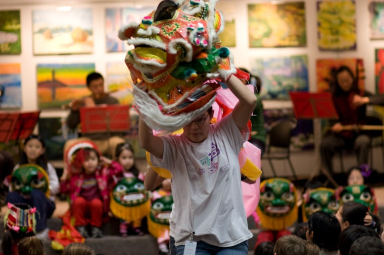 Frances Kai-Hwa Wang's daughter performs a lion dance at the Ann Arbor District Library for a Chinese New Year's presentation