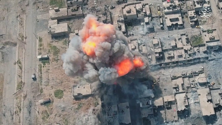 Image: A video released by ISIS purports to show explosions filmed with a drone