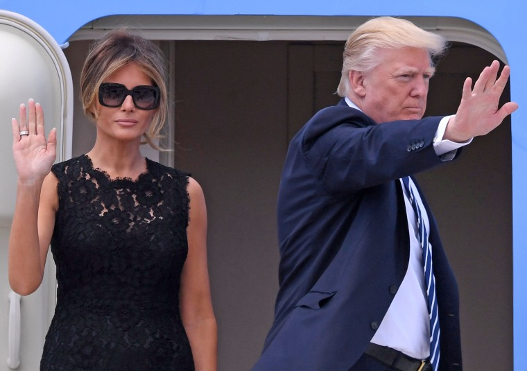 Image: U.S. President Donald Trump and first lady Melania Trump wave before boarding Air Force One at Leonardo da Vinci-Fiumicino Airport in Rome