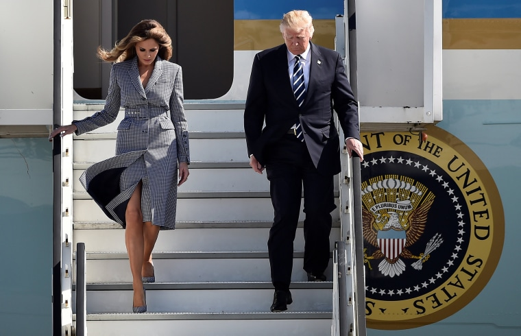 Image:  US President Donald Trump and first lady Melania Trump arrive at the Brussels Airport