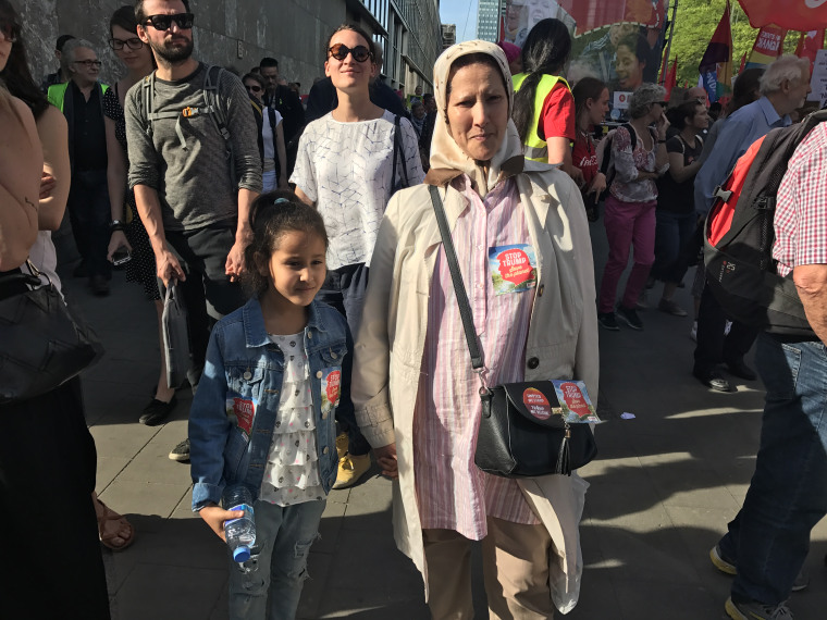 Image: Malika Bali and her granddaughter at the rally