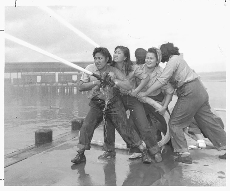 The @17.21women Instagram account shares images of Asian-American women who challenge the status quo. In this photo, a crew of women fire fighters train in Hawaii in 1941. From left to right: Elizabeth Moku, Alice Cho, Katherine Lowe, and Hilda Van Gieson.