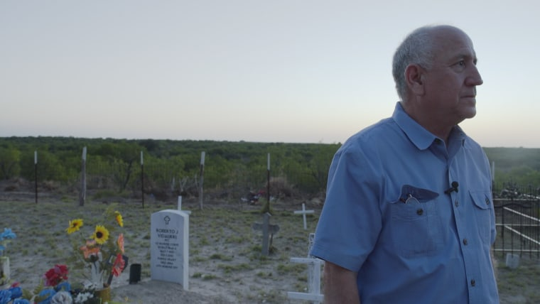 Maurico Vidaurri stands in the cemetery on his family ranch south of Laredo, Texas.