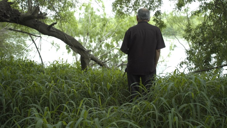 Noel Benavides looks out at the Rio Grande River from his property in Roma, Texas.