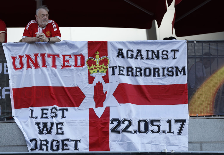 Image: Manchester United fans display a banner