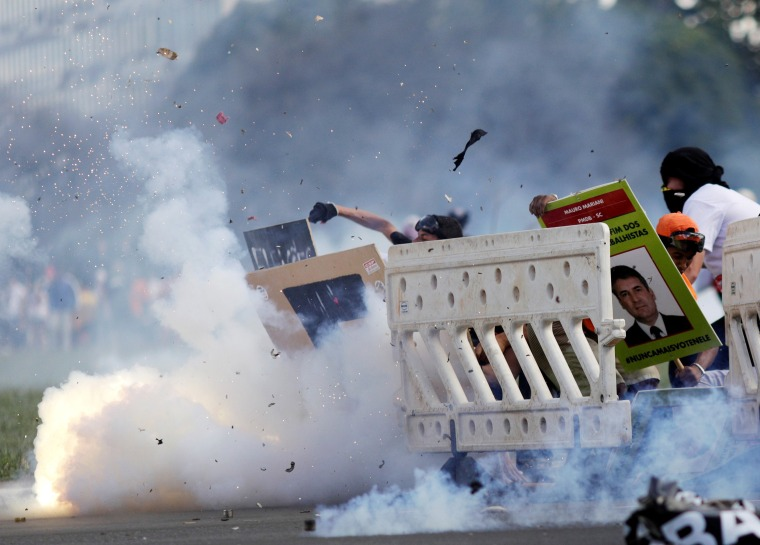 Image: Demonstrators clash with riot police officers during a protest against President Michel Temer and the latest corruption scandal to hit the country, in Brasilia