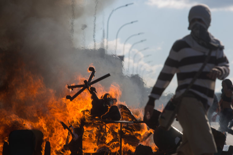 Image: Protesters set fire to furniture outside the Ministry of Agriculture during a clash in Brasilia