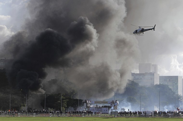Image: Demonstrators clash with police during an anti-government protest in Brasilia