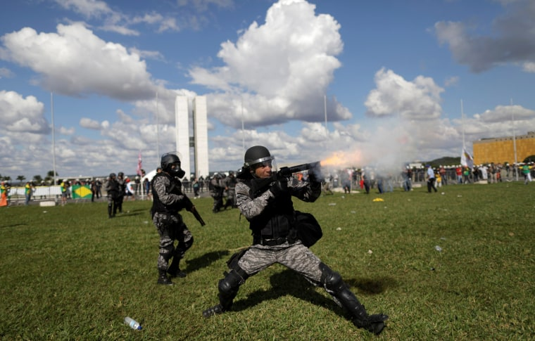 Image: Riot police clash with demonstrators during a protest in Brasilia