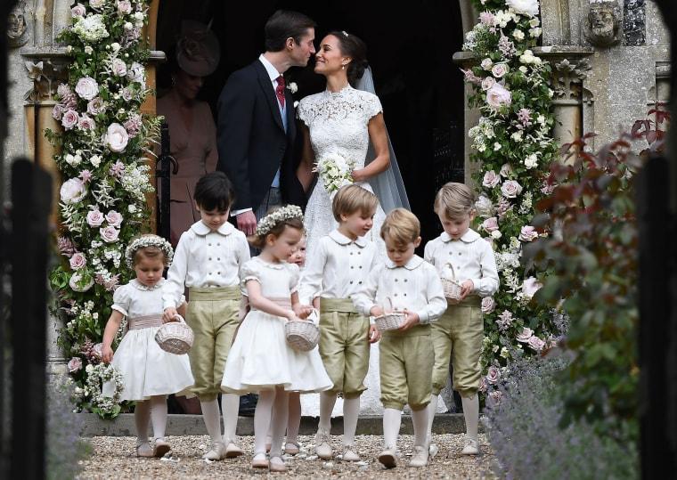 Image: Pippa Middleton kisses her new husband James Matthews